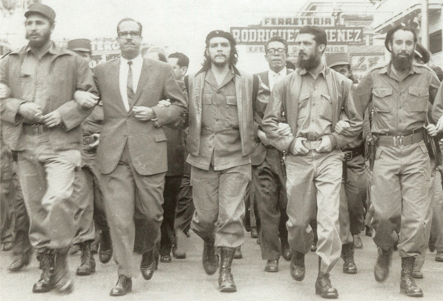 Fidel Castro, Osvaldo Dorticos (president of Cuba), Ernesto Che Guevara march in Havana on March 5, 1960, the day after the explosion of French freighter La Coubre that brought 76 tons of Belgian munitions. (Author: Unknown)