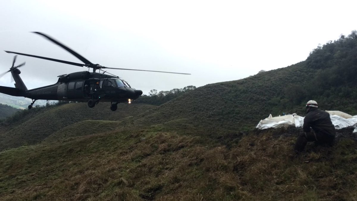 Colombian Air Force helicopter aids in search and rescue after the crash of a plane carrying Brazilian soceer team and journalists.